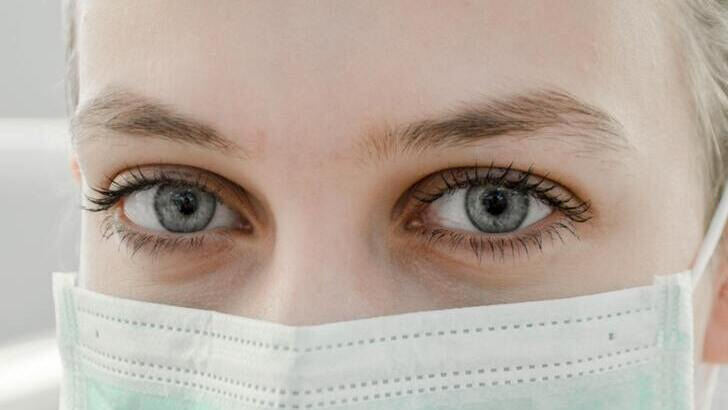 Close up of woman's eye wearing mask photo - NeedMask